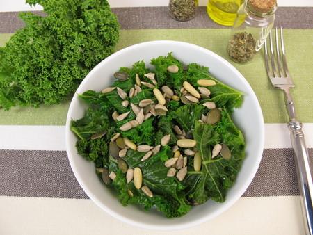 sunflower seeds: Kale salad with sunflower seeds, pine nuts, pumpkin seeds Stock Photo