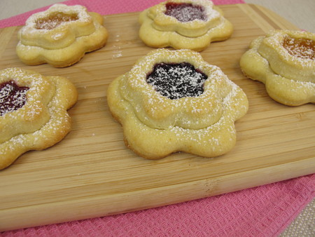 filled: Flower biscuits filled with jam Stock Photo