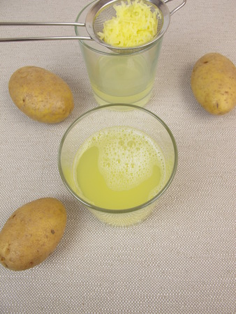 Freshly pressed raw potato juice Archivio Fotografico