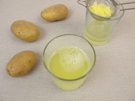 Freshly pressed raw potato juice Stock Photo
