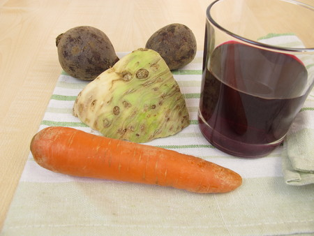 celeriac: Vegetable juice with beetroot, carrots and celery root Stock Photo