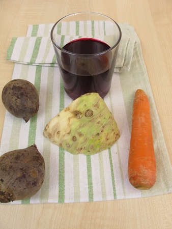 celery root: Vegetable juice with beetroot, carrots and celery root Stock Photo