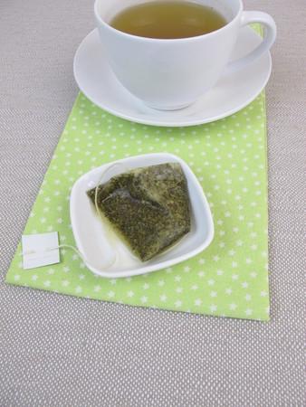 tea bag: Cup of herbal tea with matcha tea bag