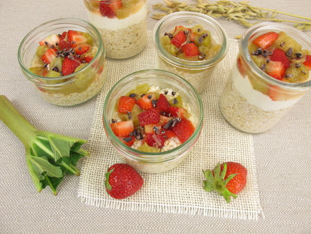quark: Overnight Oats with quark, rhubarb, strawberries and cocoa nibs