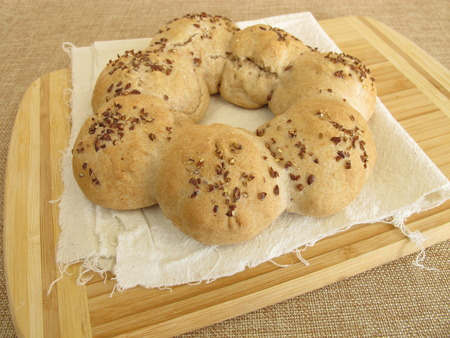 flax seeds: Homemade roll wreath with flax seeds Stock Photo