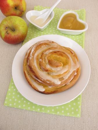 apple snail: Pinwheel with apple sauce and sugar icing Stock Photo