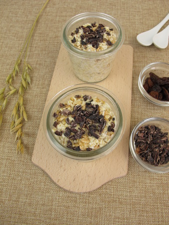 overnight: Overnight Oats with cocoa nibs and sultanas Stock Photo