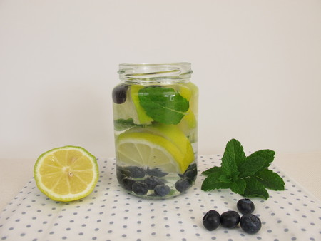 detoxification: Detox water with lemon, blueberries and mint leaves in jar