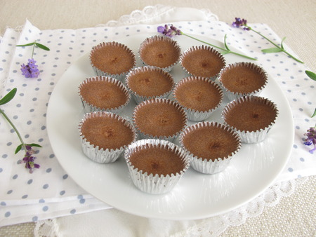 Homemade ice chocolate with cocoa powder, powdered sugar and coconut oil in aluminum mini cups Stock Photo