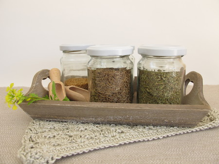 dried herbs: Dried herbs and spices in jars