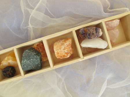 crystal healing: Stones for crystal healing in wooden box Stock Photo