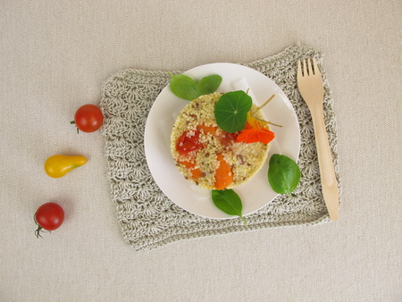 turret: Millet turret with tomatoes, carrots and herbs