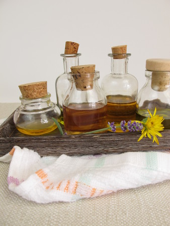 Vegetable oils for the skin care in bottles on a tray Stock Photo