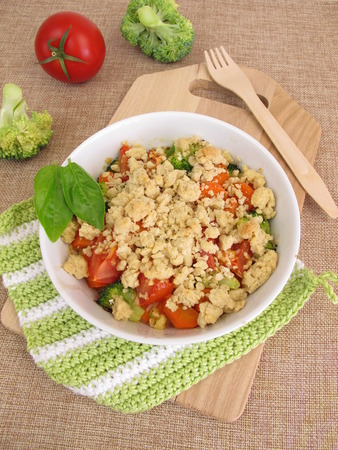 Vegetable crumble with carrots, tomatoes and broccoli Stock Photo