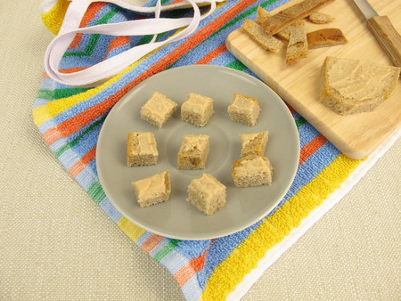 godfather: Bread cubes with pate as finger food for toddlers