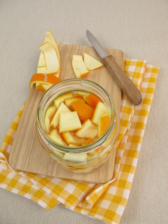 Homemade ecological household detergent with orange peel and vinegar Stock Photo