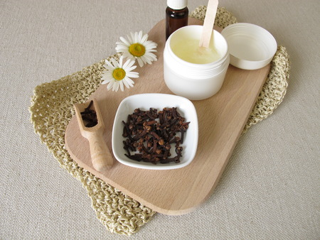 Homemade insect repellent oil against mosquitoes with coconut oil and clove oil