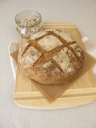 Homemade rye bread with rye crops and seeds Imagens