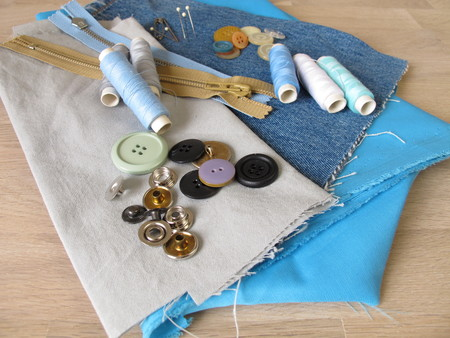 pin code: Sewing material with fabric, twine and buttons Stock Photo