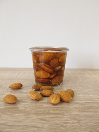 With water soaked and activated almonds Stock Photo