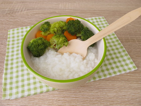 Rice congee with broccoli and carrot Stock Photo