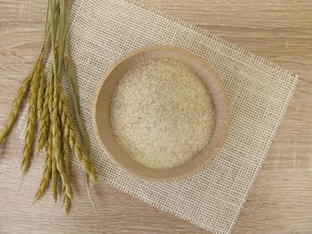 Spelled semolina in wooden bowl Stock Photo