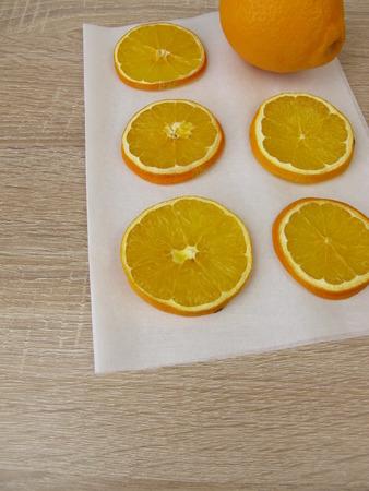 Dried sweet orange slices on paper