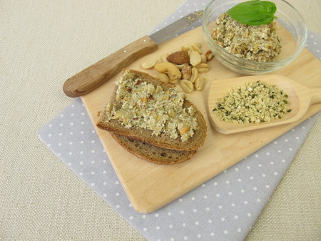 Bread with vegan spread from peeled hemp seeds, nuts and herbs Stock Photo