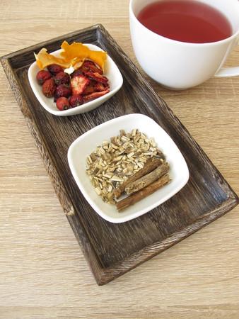 Ingredients for fruit tea with dried fruits, orange peel and liquorice root Standard-Bild - 111298250