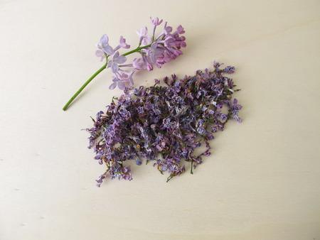 Dried lilac flowers on wooden board Zdjęcie Seryjne