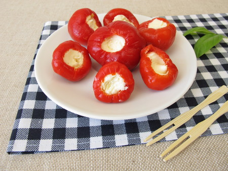 Red cherry pepper stuffed with fresh cheese