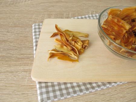 Dried jackfruit on cutting board Reklamní fotografie