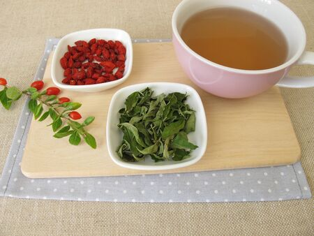 Tea with dried goji berries and goji leaves