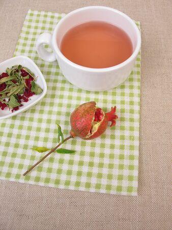 A cup of pomegranate fruit tea