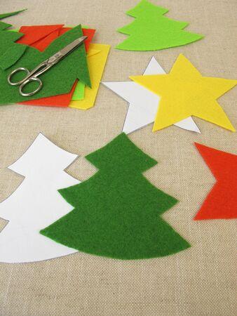 Handmade christmas stars and christmas trees made of felt