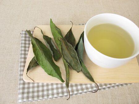 A cup of avocado leaf tea, tea with dried avocado leaves