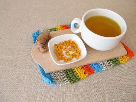 Golden yellow tea with dried turmeric
