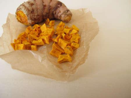 Dried turmeric, curcuma root in wax paper Archivio Fotografico