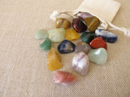 Tumbled colorful gemstones in a small bag