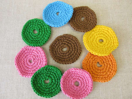 Crocheted, reusable, washable cosmetic pads from colorful wool Archivio Fotografico