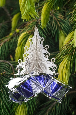Silver Christmas Tree with Small Silver And Blue Drums Hanging On A Tree  Decoration  photo