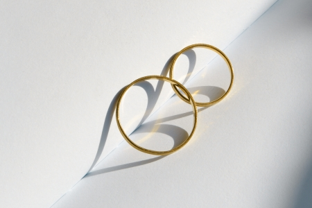 wedding rings: Wedding rings with a heart-shaped shadow Stock Photo