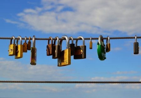 permanently: Padlocks on a bridge as a sign of love Stock Photo