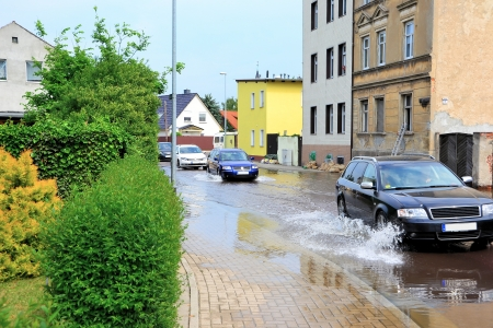 the flood tide: flooded street during floods in magdeburg