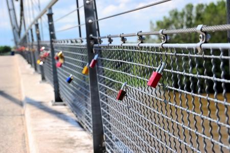 complete crossing: Padlocks on a bridge in Magdeburg Editorial