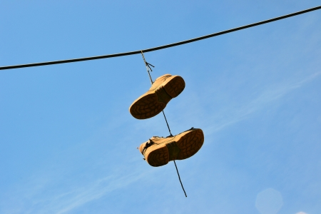 Hanging shoes on a power cable in Magdeburg Stock Photo