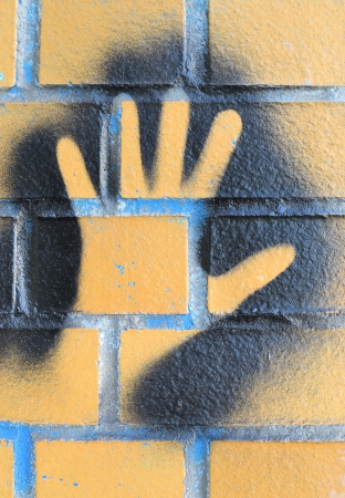 defaced: a handprint as a graffiti