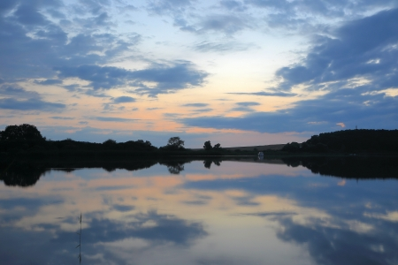 blinded: Evening atmosphere by a lake in Brandenburg