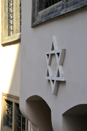 persecution: Star of David on a facade in Prague