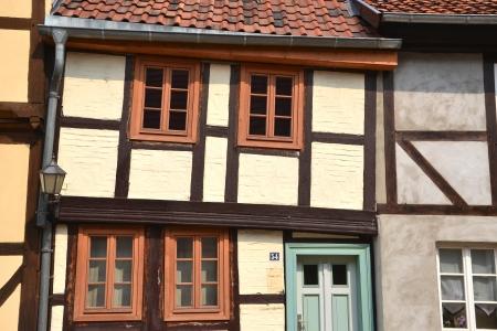 Crooked timber-framed house in Quedlinburg photo